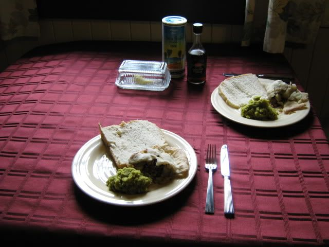 Meat &amp; potato pie, mushy peas, and bread